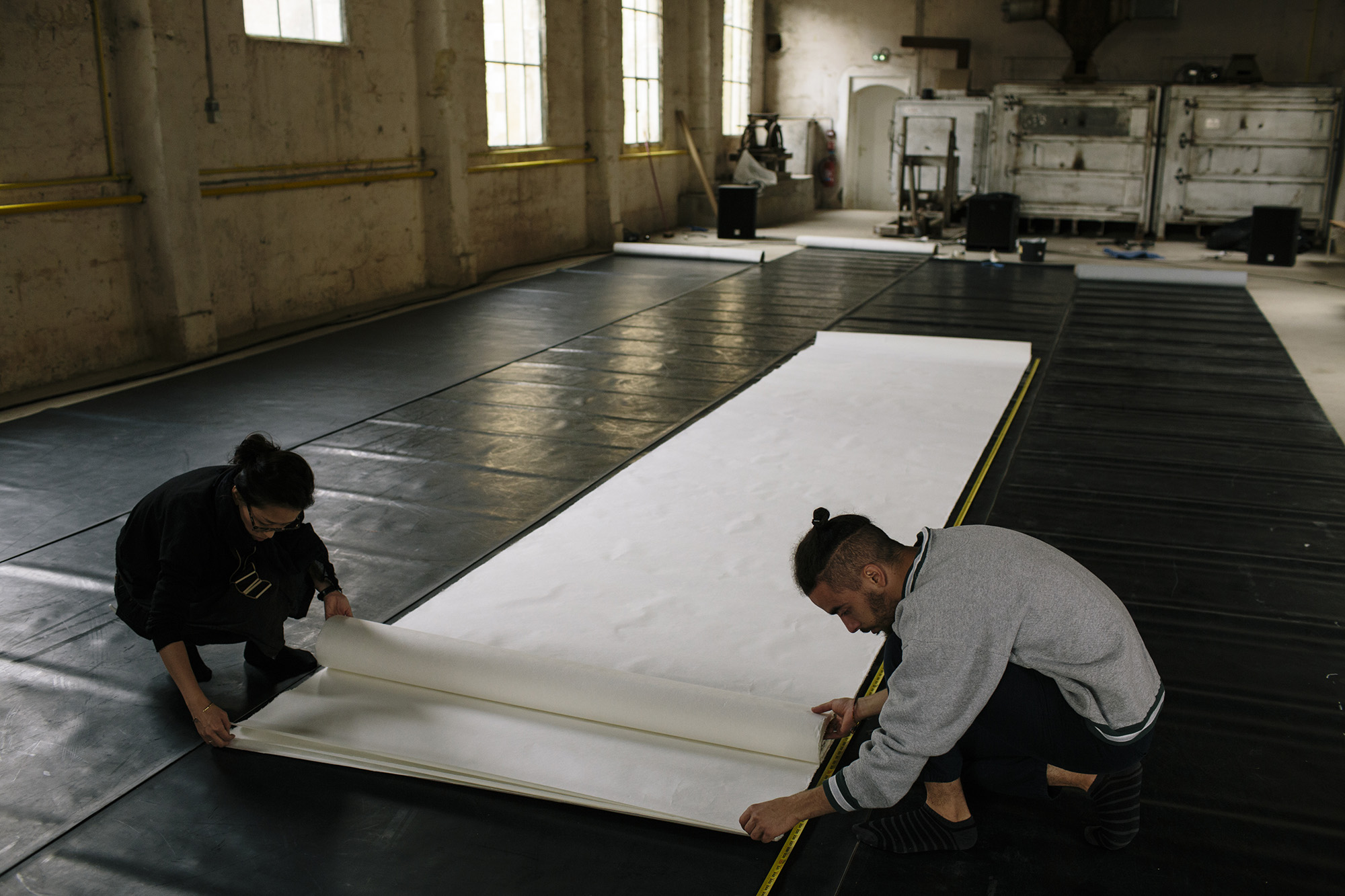 Aoi & Farid preparing the paper _ photo by Corey Fuller